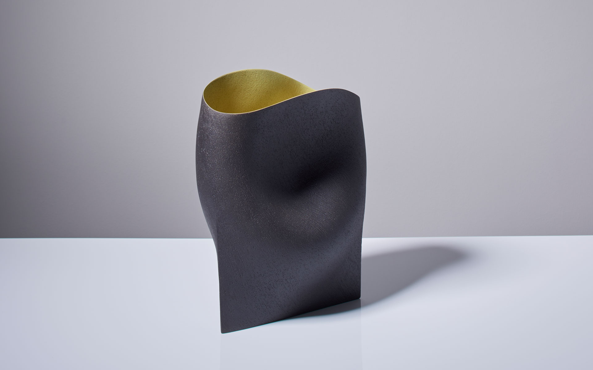 Black Vessel with yellow interior