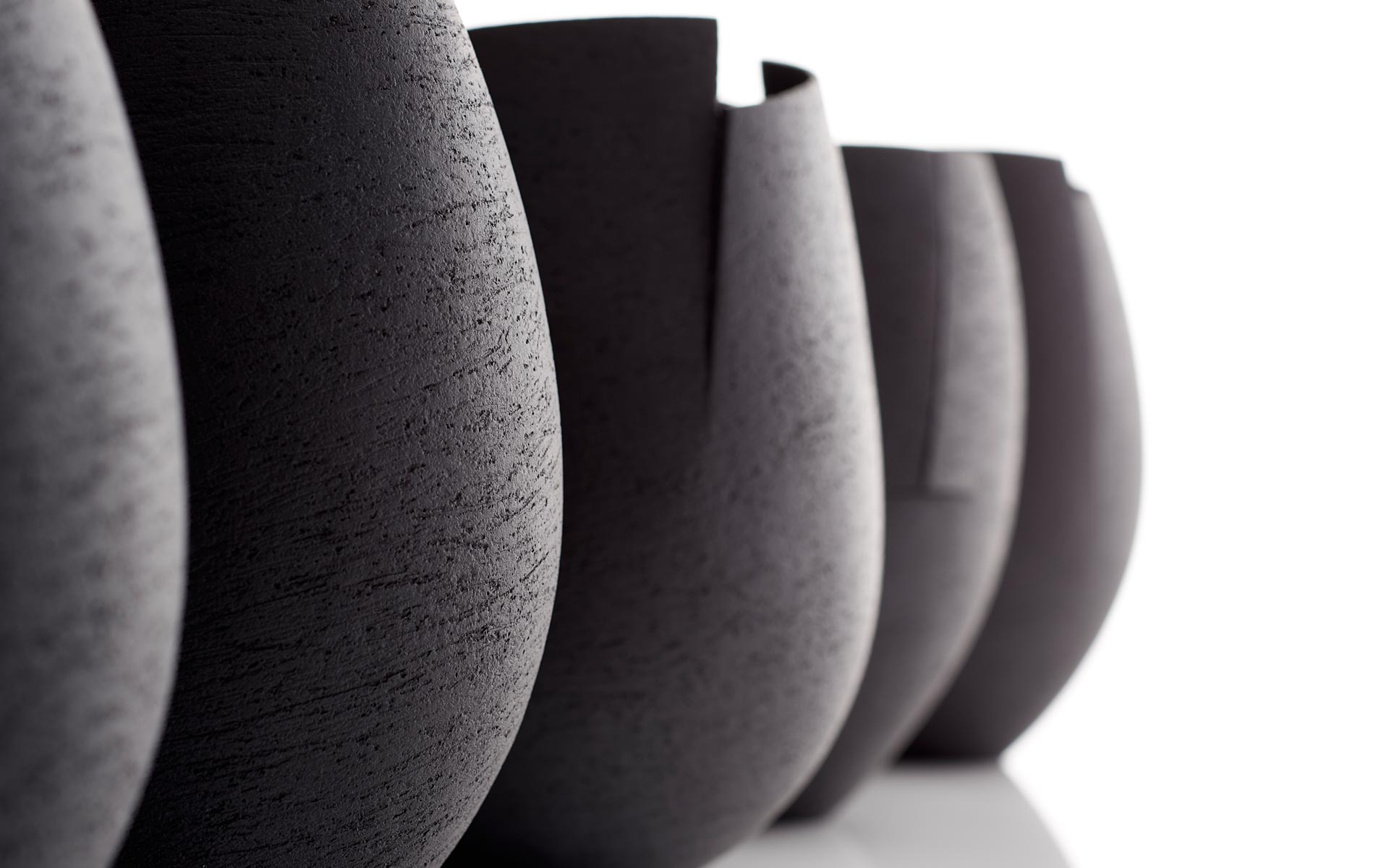 Group of Small Black Cut Vessels - Detail